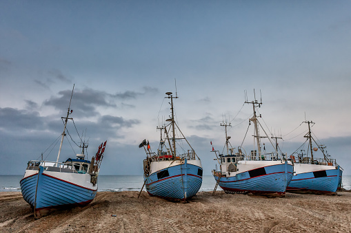 Fishing boats on land at Thorup beach on the Danish North Sea coast